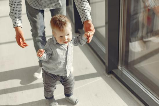 little-baby-boy-standing-and-learning-to-walk-3875196
