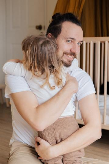 man-in-white-t-shirt-hugging-child-in-white-t-shirt-3933270
