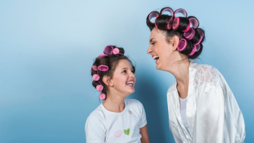 cute-mother-daughter-curlers-laughing_23-2148070352