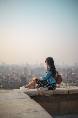 woman-sitting-on-top-of-building-s-edge-1755385